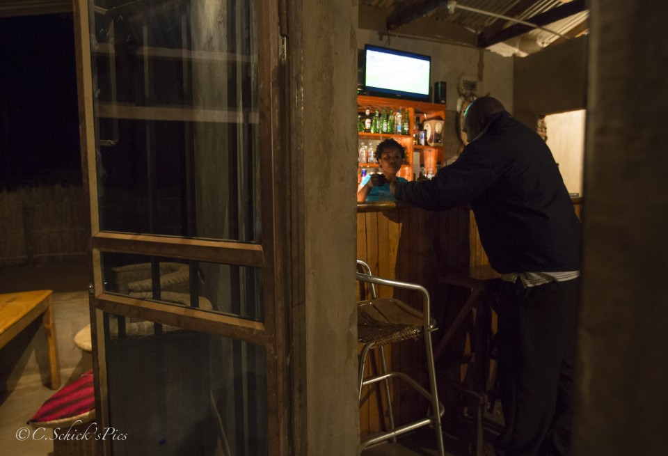 Doris Ngwenya, a hip, independent, successful business owner, serves a drink in her bar at Mwami border on the border of Malawi and Zambia, on June 7, 2016. -- (Crystal Schick/Independent Photojournalist)