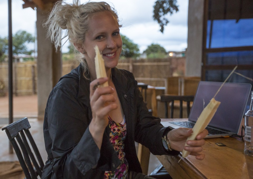 Doris Ngwenya, a hip, independent, successful business owner, takes a snap of me eating sugar cane for the first time at her bar at Mwami border in Zambia, on June 7, 2016. -- (Crystal Schick/Independent Photojournalist)