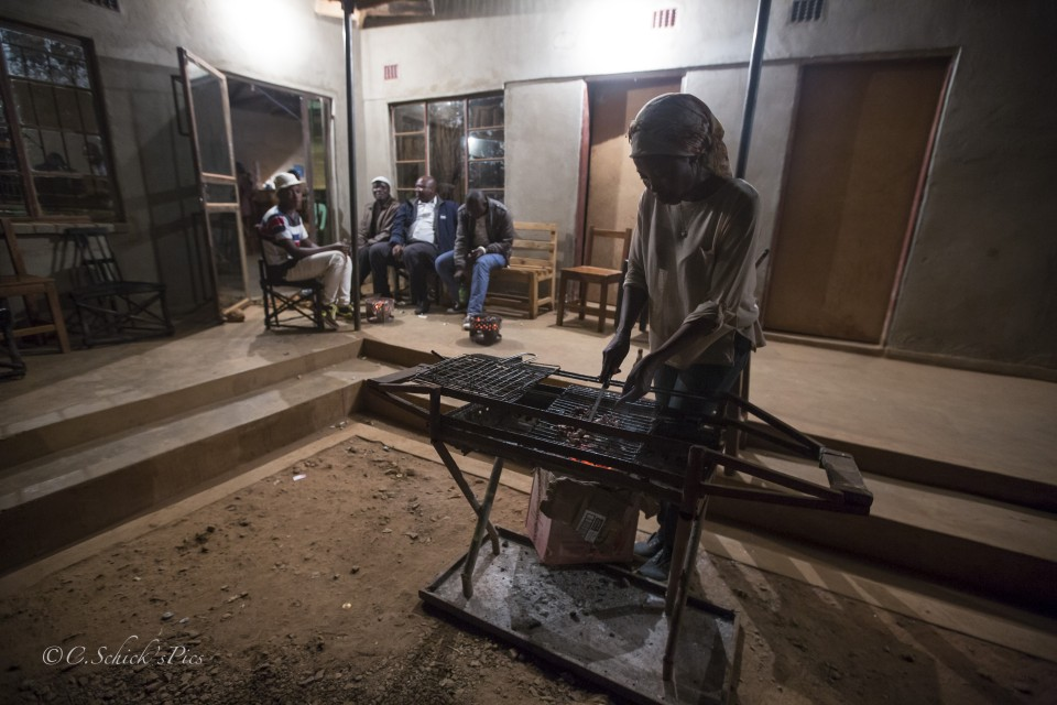"Doris Ngwenya, a hip, independent, successful business owner, grills up some meat for her ""boys"", like she does almost every night at her bar at Mwami border in Zambia on June 7, 2016. --  (Crystal Schick/Independent Photojournalist)"