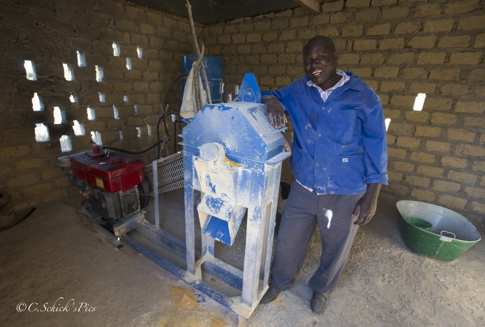 Fizwell Mudima stands next to the hammer mill he recieved from Rent To Own in his rural home about 30 minutes outside Chibombo in Zambia, on June 9, 2016. The mill is used to turn corm kernels into a flour like substance. -- (Crystal Schick/Independent Photojournalist)