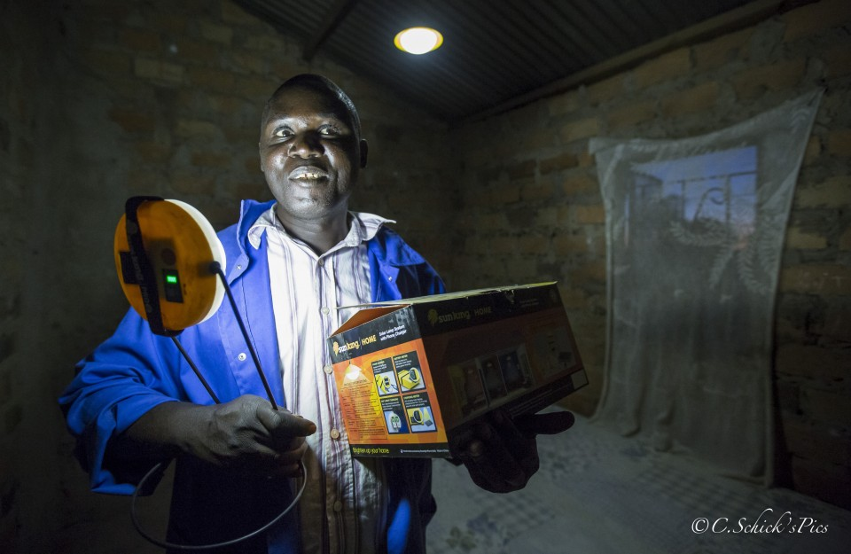 Fizwell Mudima shows a solar light kit he recieved from Rent To Own in his rural home about 30 minutes outside Chibombo in Zambia, on June 9, 2016. -- (Crystal Schick/Independent Photojournalist)