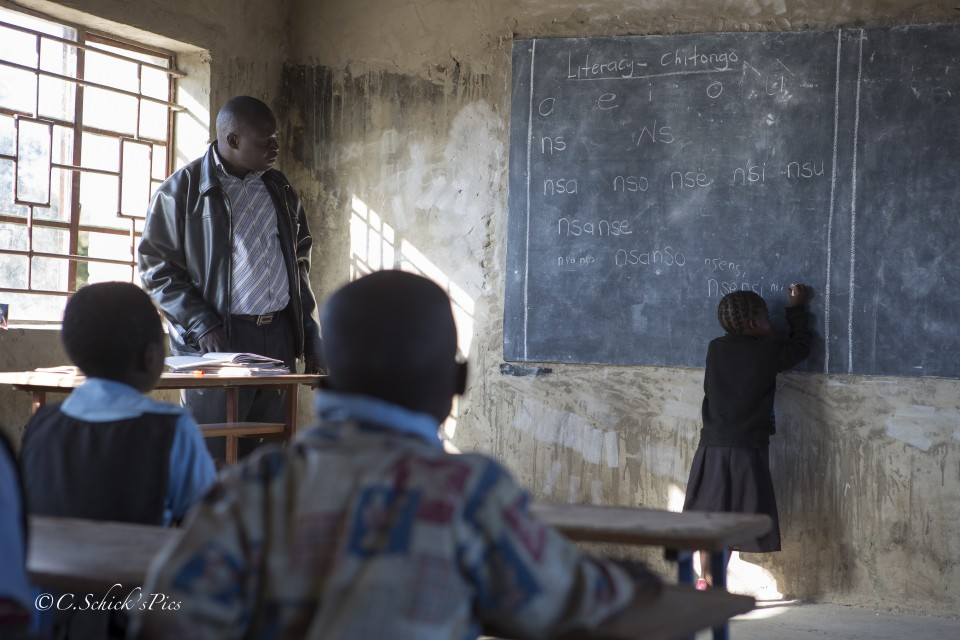 Fizwell watches as on of his students answers a question on the chalkboard in a rural school about 30 minutes outside Chibombo in Zambia, on June 9, 2016. -- (Crystal Schick/Independent Photojournalist)