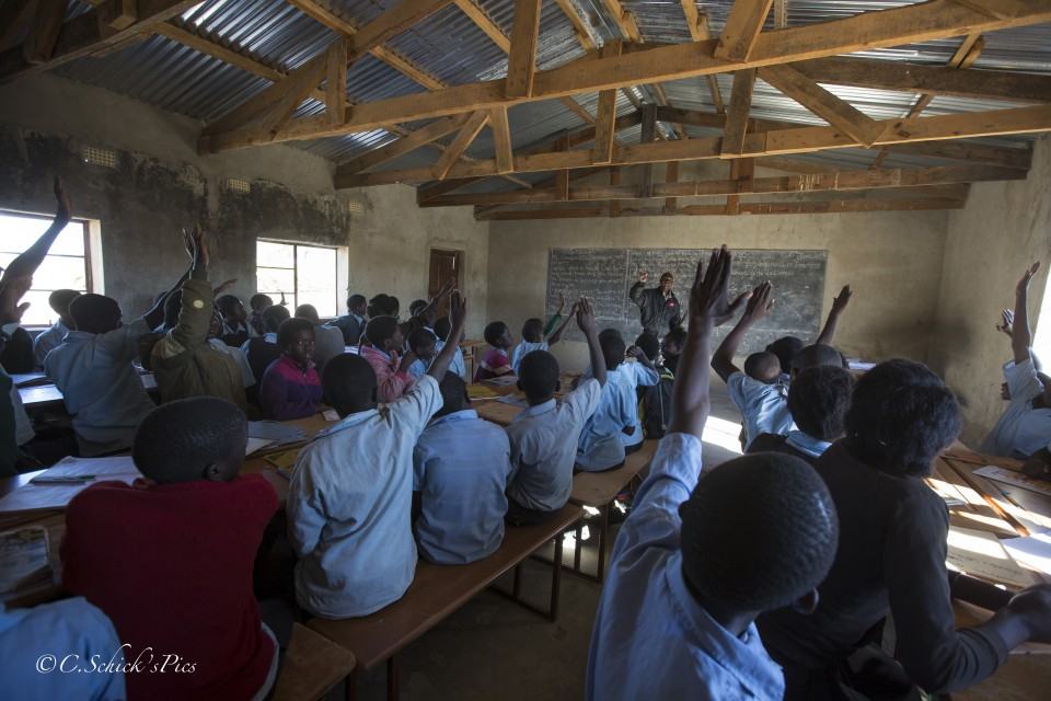 Frank Bwalya, one of Fizwell's coleagues, teaches math on the chalkboard to seventh grade students in a rural school about 30 minutes outside Chibombo in Zambia, on June 9, 2016. -- (Crystal Schick/Independent Photojournalist)