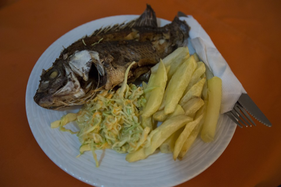 Lunch with Siphiwe included a typical fish and chips dish in Kalomo in Zambia, on June 16, 2016. -- (Crystal Schick/Independent Photojournalist)