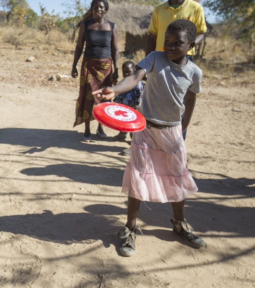 Siphiwe learns to use the frisbee I brought her as a gift from Canada at her Kalomo district home in Zambia, on June 16, 2016. --  (Crystal Schick/)