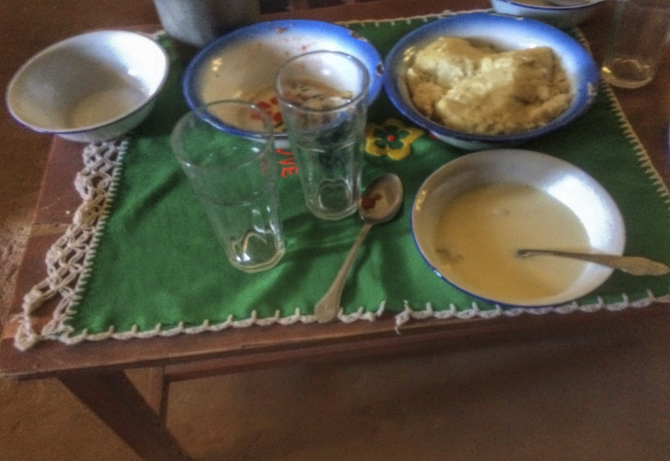 A bowl of nshima on the top right and the nshima sour milk mix in the bowl on the bottom right, in the rural home of Fizwell Mudima about 30 minutes outside Chibombo, Zambia.
