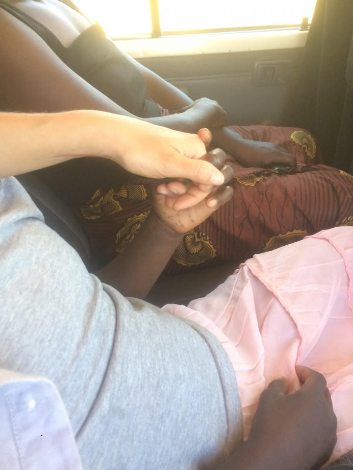 Iphone picture. Siphiwe holds my hand on the drive between destinations.